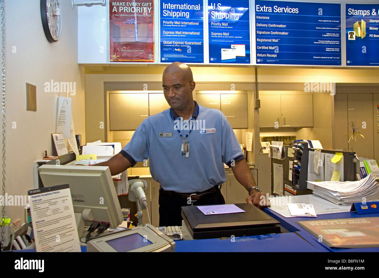 Postal worker at a post office in Boise Idaho USA - Stock Image