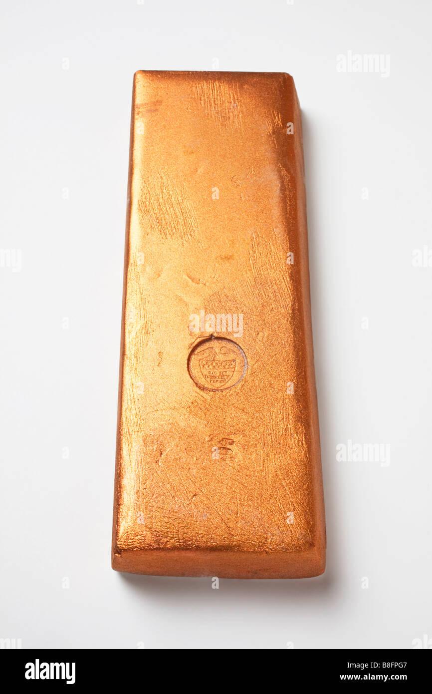 Gold bar on white background - Stock Image