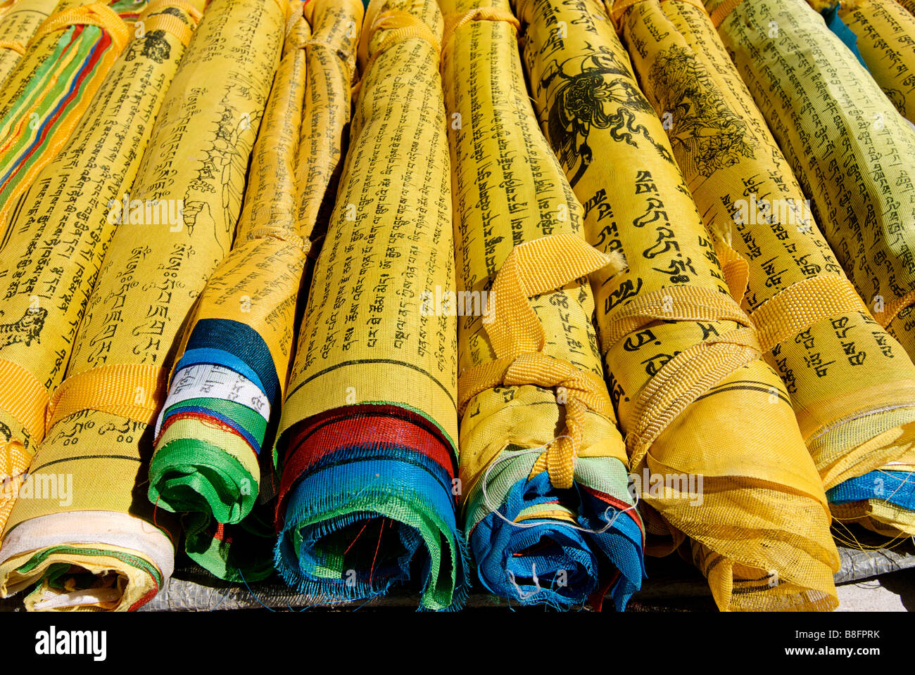 Rolled up prayer flags. Tibet - Stock Image