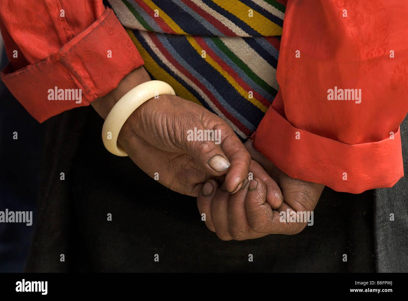 Detail of Tibetan woman's hands. Sakya, Tibet Stock Photo
