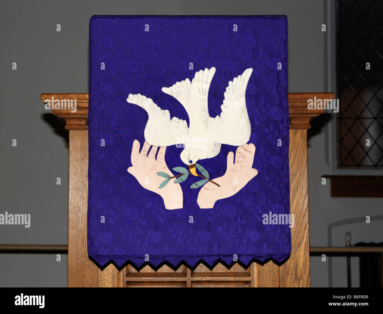 Dove of Peace with Olive Branch in its Beak Embroidery on the Lectern Methodist Church Epsom Surrey - Stock Image