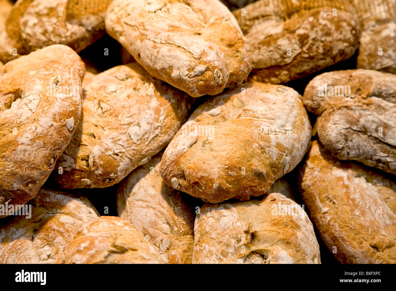 Heap of bread loaves - Stock Image