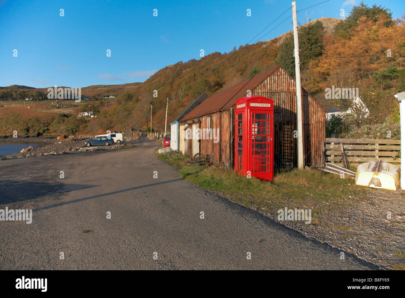 Corrugated iron Storage sheds, telephone kiosk and main street. Lower Diabaig, Wester Ross, Scotland - Stock Image