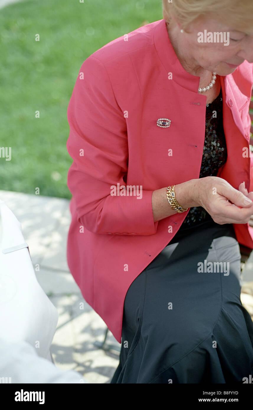 Elder Lady wearing noble Clothes - Festivity - Seniority - Stock Image
