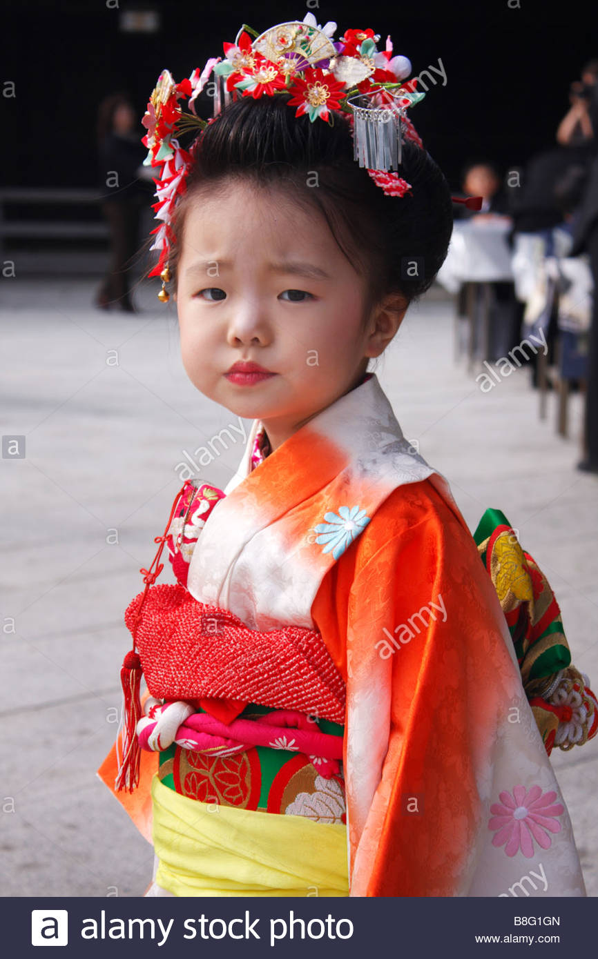 A little girl poses for her photograph during 7-5-3 festival in Tokyo, Japan - Stock Image