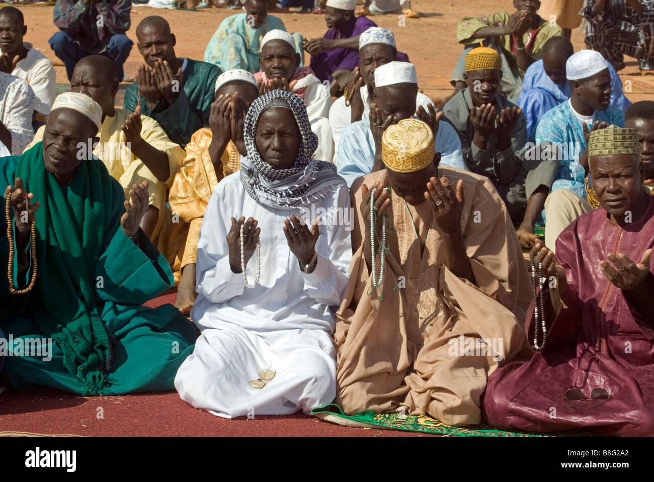 Muslim Africans in a feast of sacrifice pray Ouagadougou Burkina Faso - Stock Image