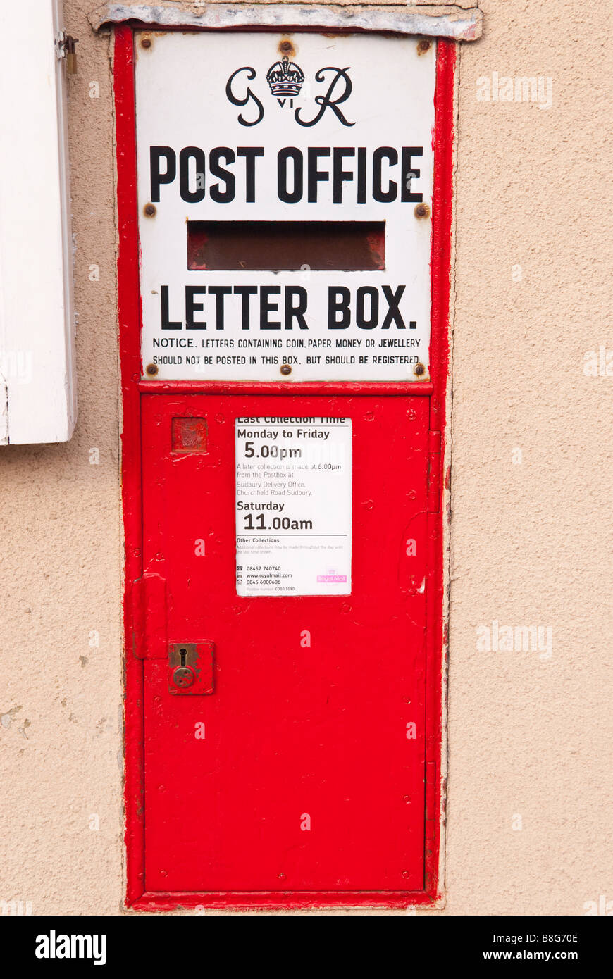 A red royal mail GR post office letter posting box in the uk Stock Photo