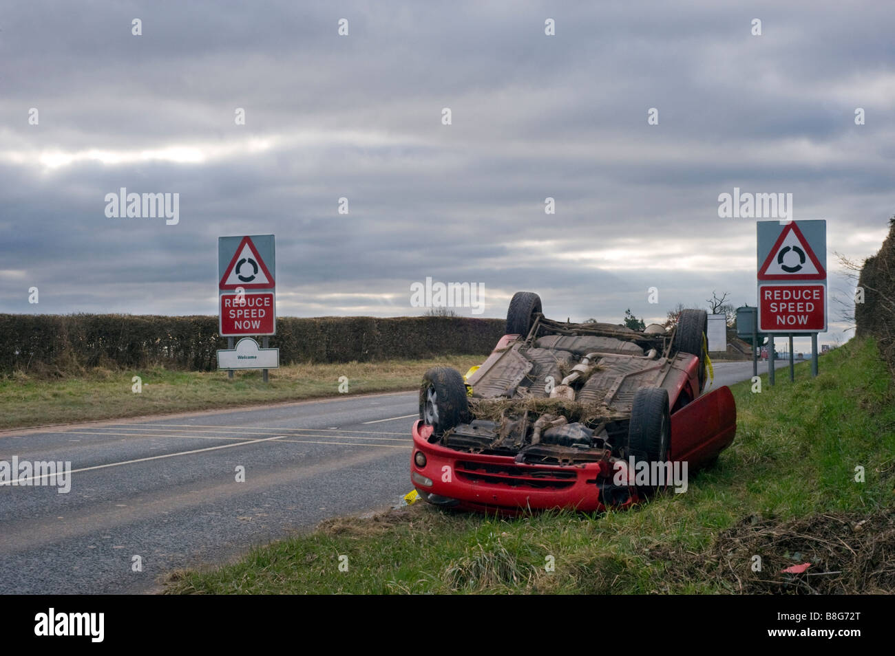 Car Crash Car Wreck Of Sports Car With Reduce Speed Signs In Stock