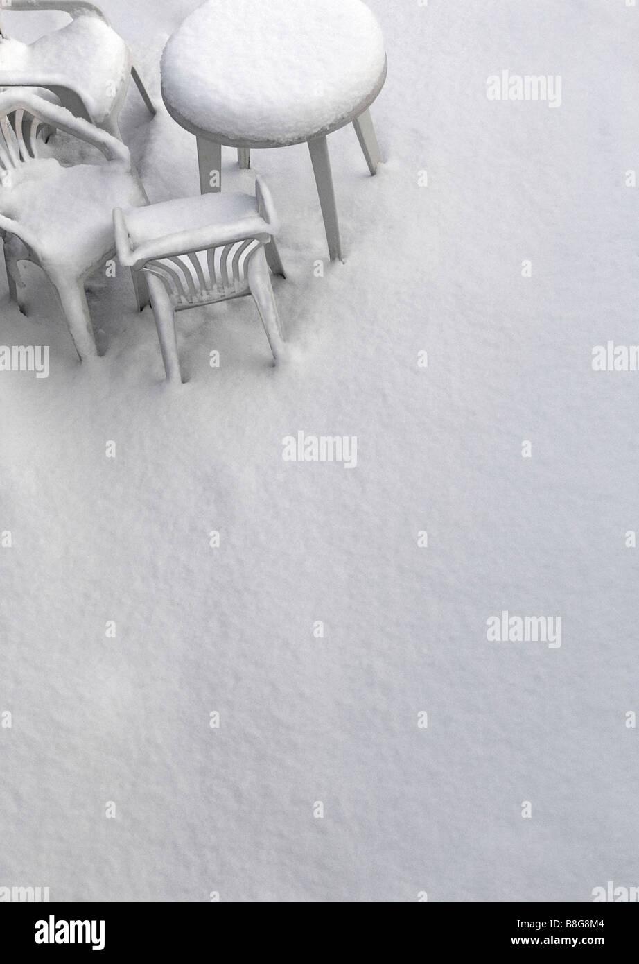 Heavy snowfall on garden furniture.  Winter Scene in England UK Stock Photo
