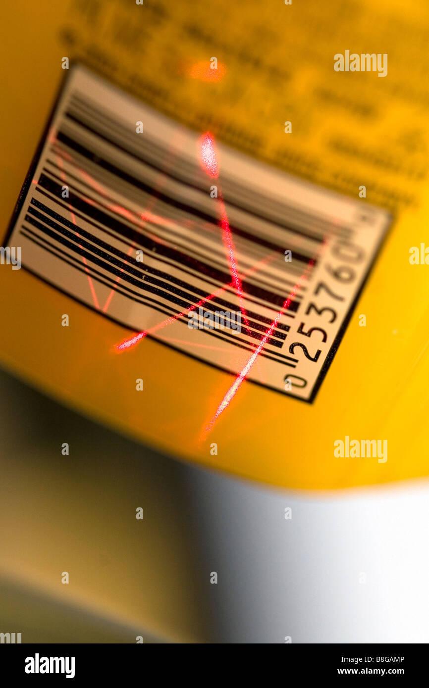 Laser scanning a UPC barcode - Stock Image