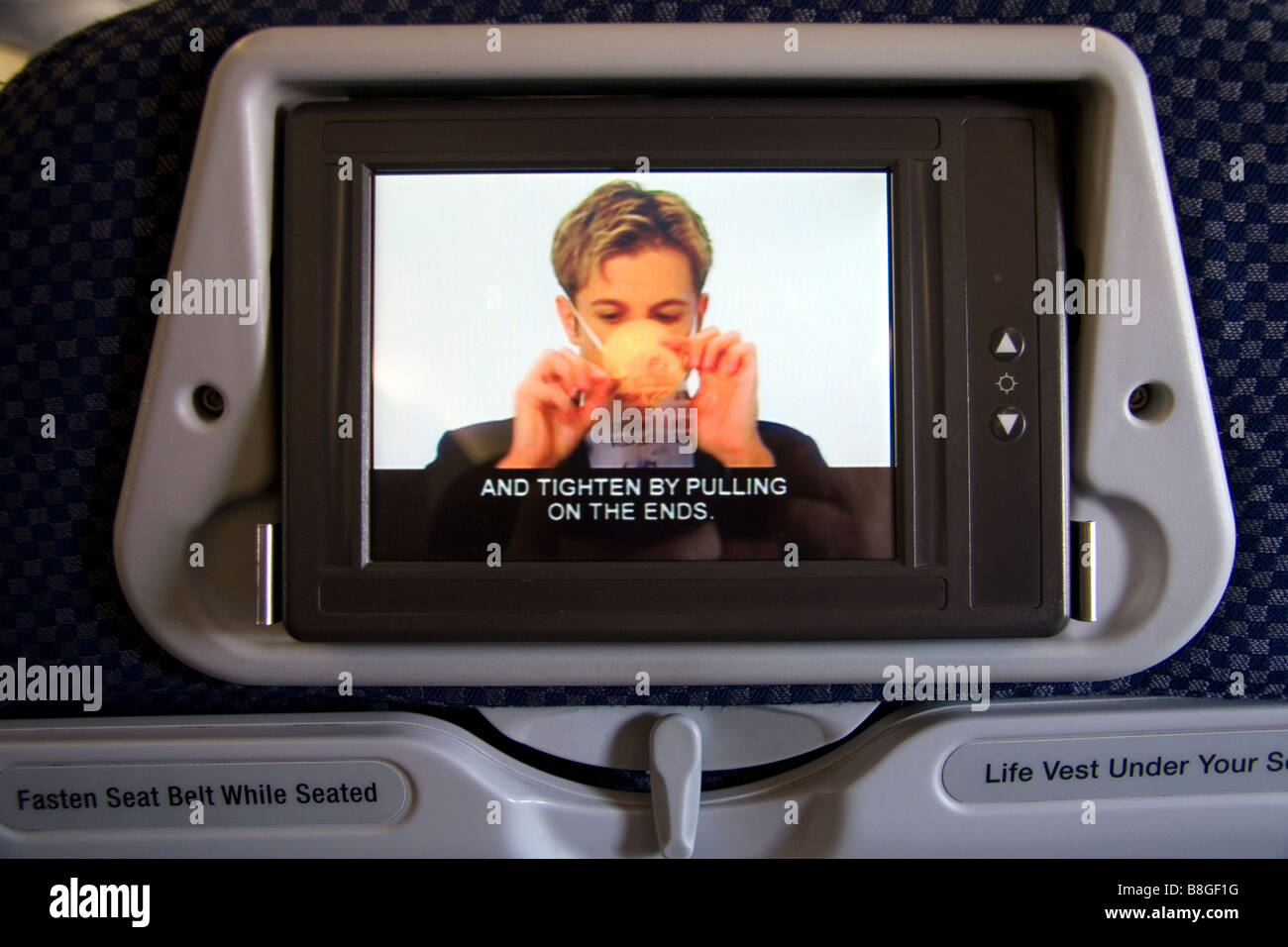Seatback video safety instructions on an Airbus A 330 airliner - Stock Image