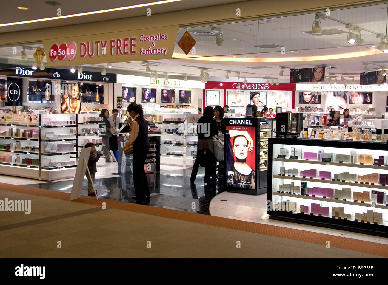 Travelers shop at a duty free store in the Narita International Airport Tokyo Japan - Stock Image