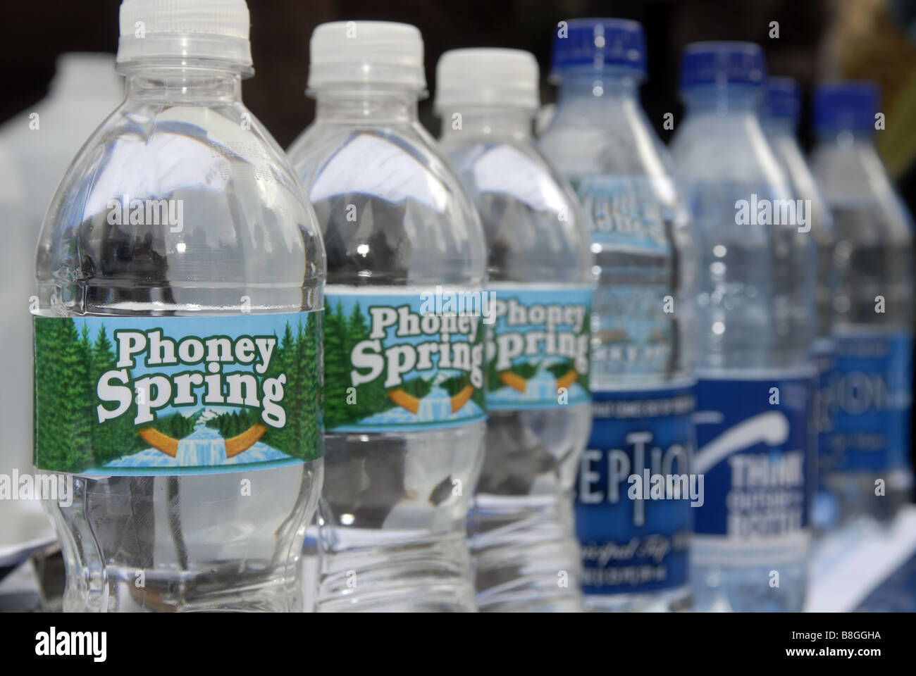 Parody bottles of water at a bottled water protest in New York - Stock Image