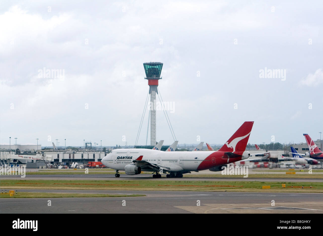 Airliners on the runway at London Heathrow Airport England United Kingdom - Stock Image
