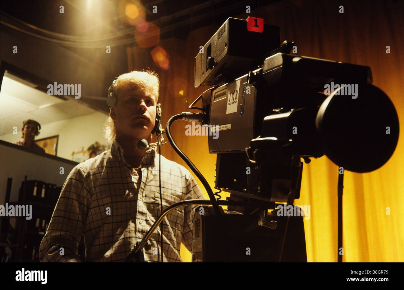 People working,TV cameraman in Television Studio - Stock Image