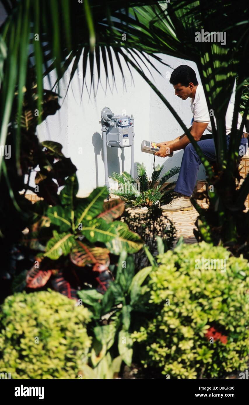 People working,Gas meter reader making reading Miami - Stock Image