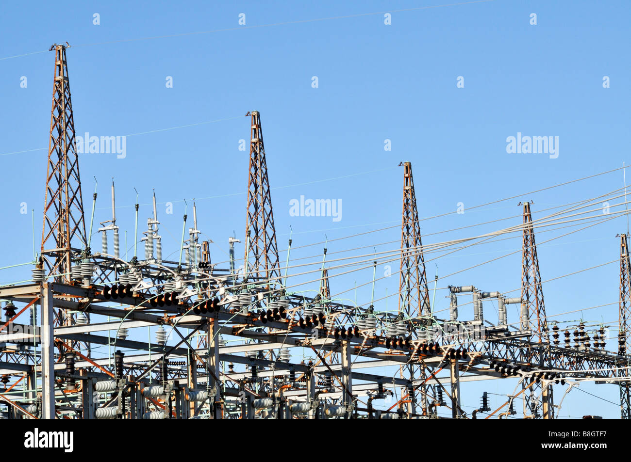 Electric power substation switch towers with switches circuit breakers lines lightning rods and voltage regulators - Stock Image