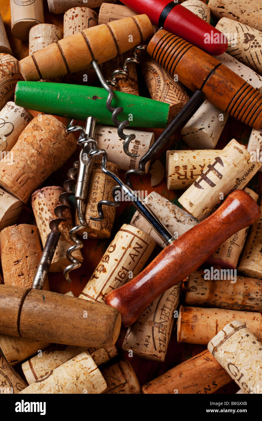 Assorted corkscrews and wine corks - Stock Image