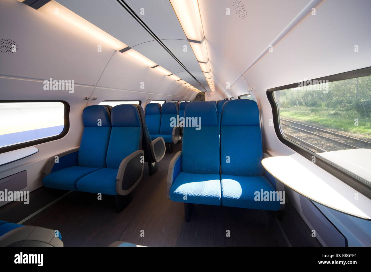 Interior of the upper deck of a double-decker or bi-level car Dutch commuter train. - Stock Image