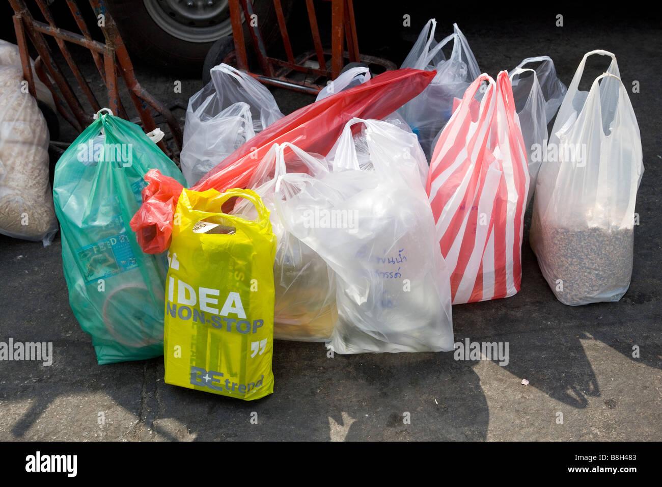 Carrier Bags full of shopping at Chatuchak Weekend Market Bangkok - Stock Image