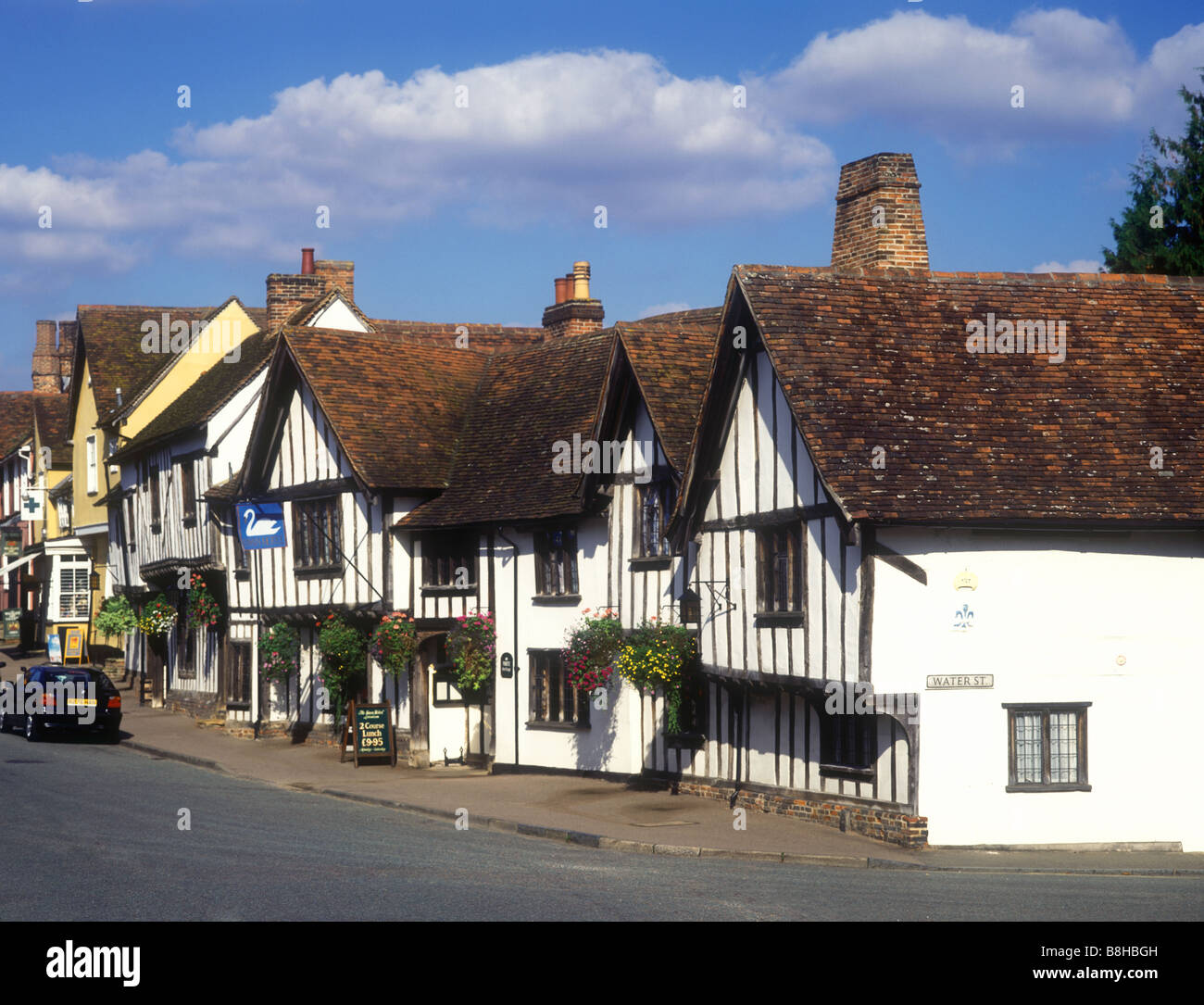 Street scene in the village of Lavenham showing the Swan Hotel, a medieval half-timbered building - Stock Image