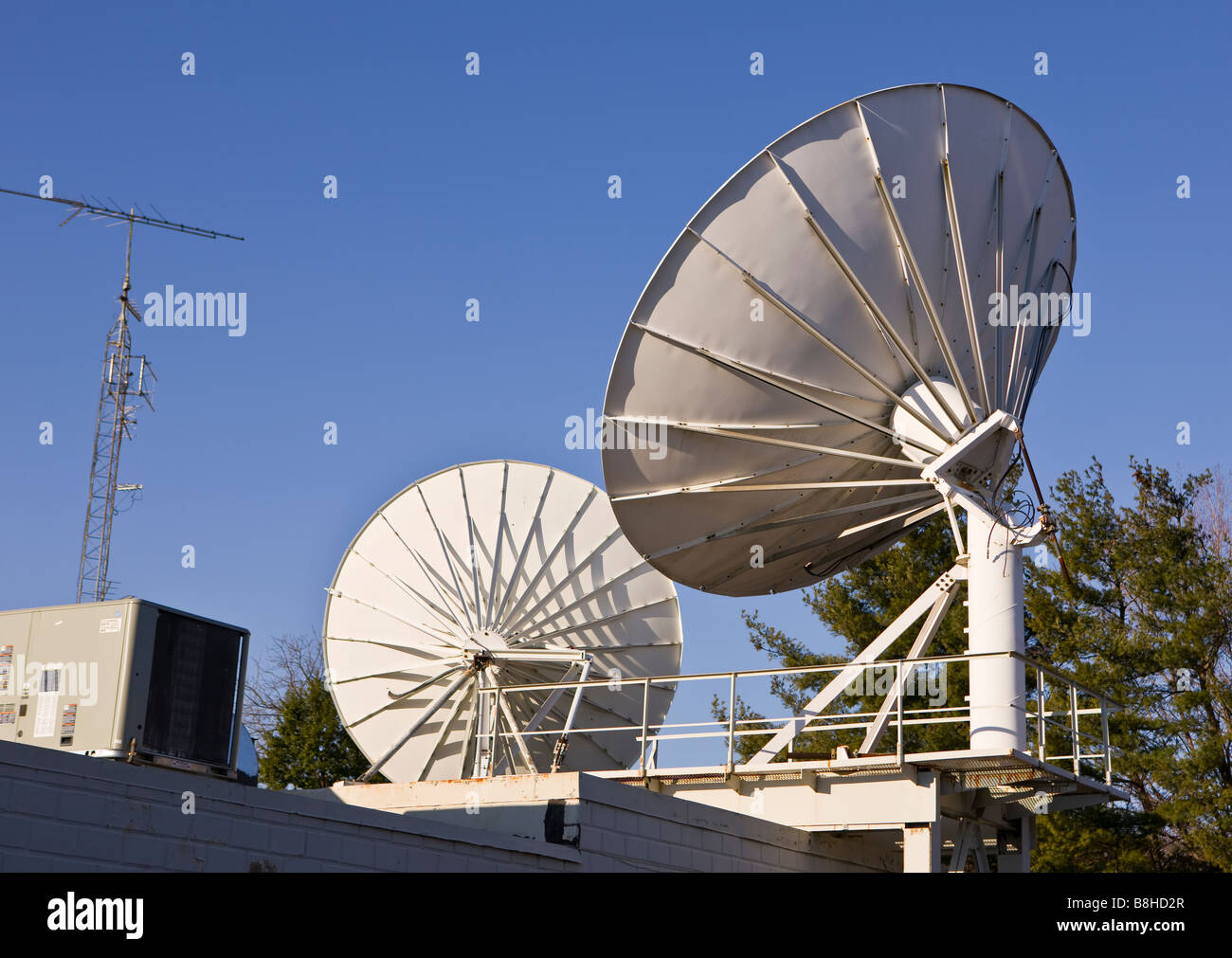 ARLINGTON VIRGINIA USA Satellite dish for cable TV on roof Stock Photo