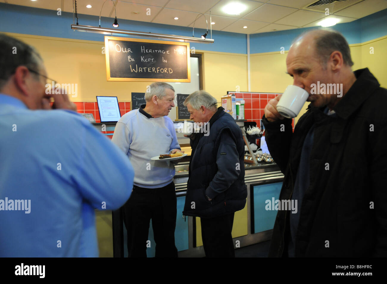Workers occupying the cafe of the visitors centre in the Waterford crystal factory in Waterford Ireland - Stock Image
