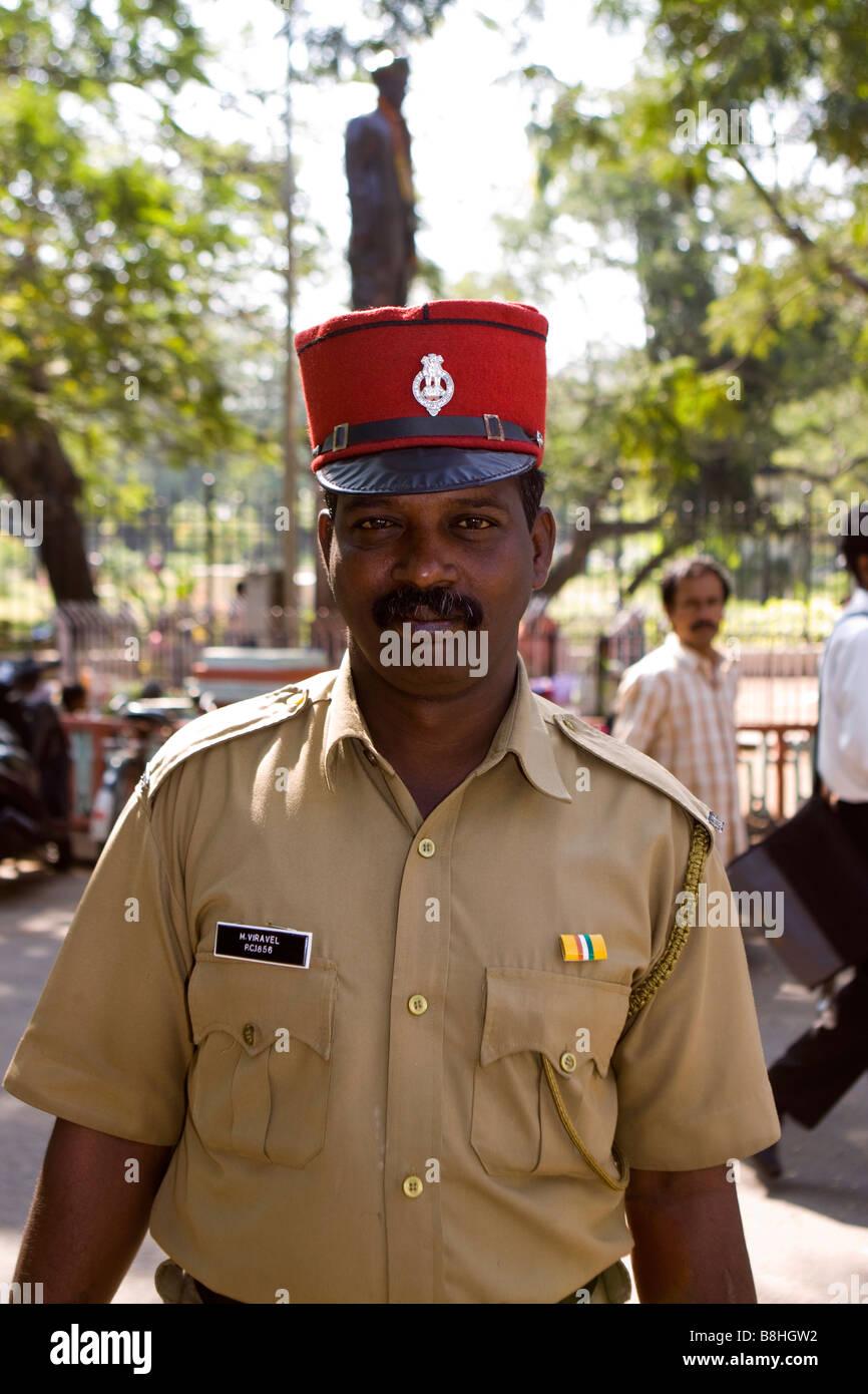 ec019fbc52b India Pondicherry local policeman wearing red French police kepi hat -  Stock Image