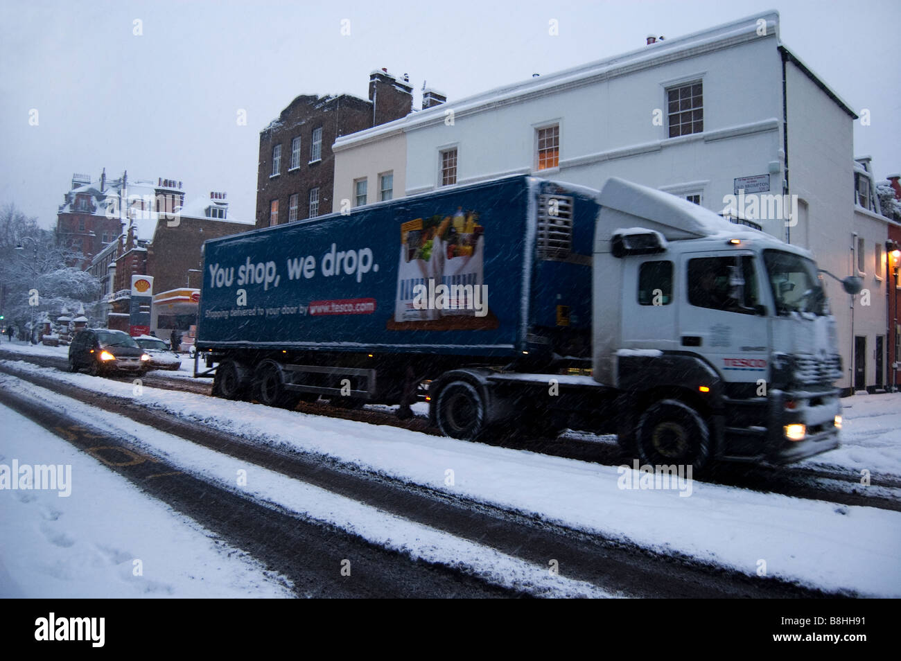 Tesco HGV in the snow - Stock Image
