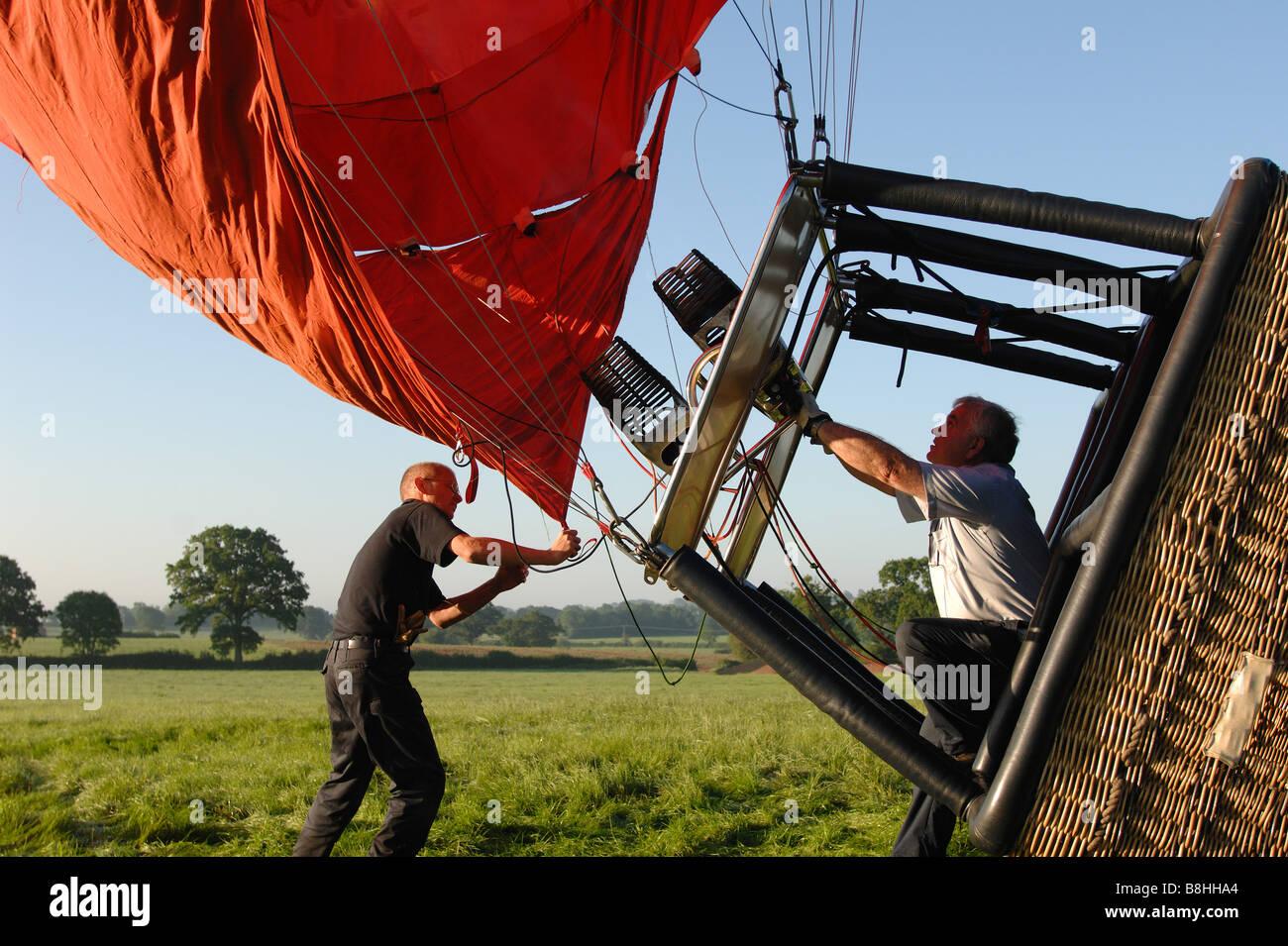 A hot air balloon prepairig for a flight - Stock Image