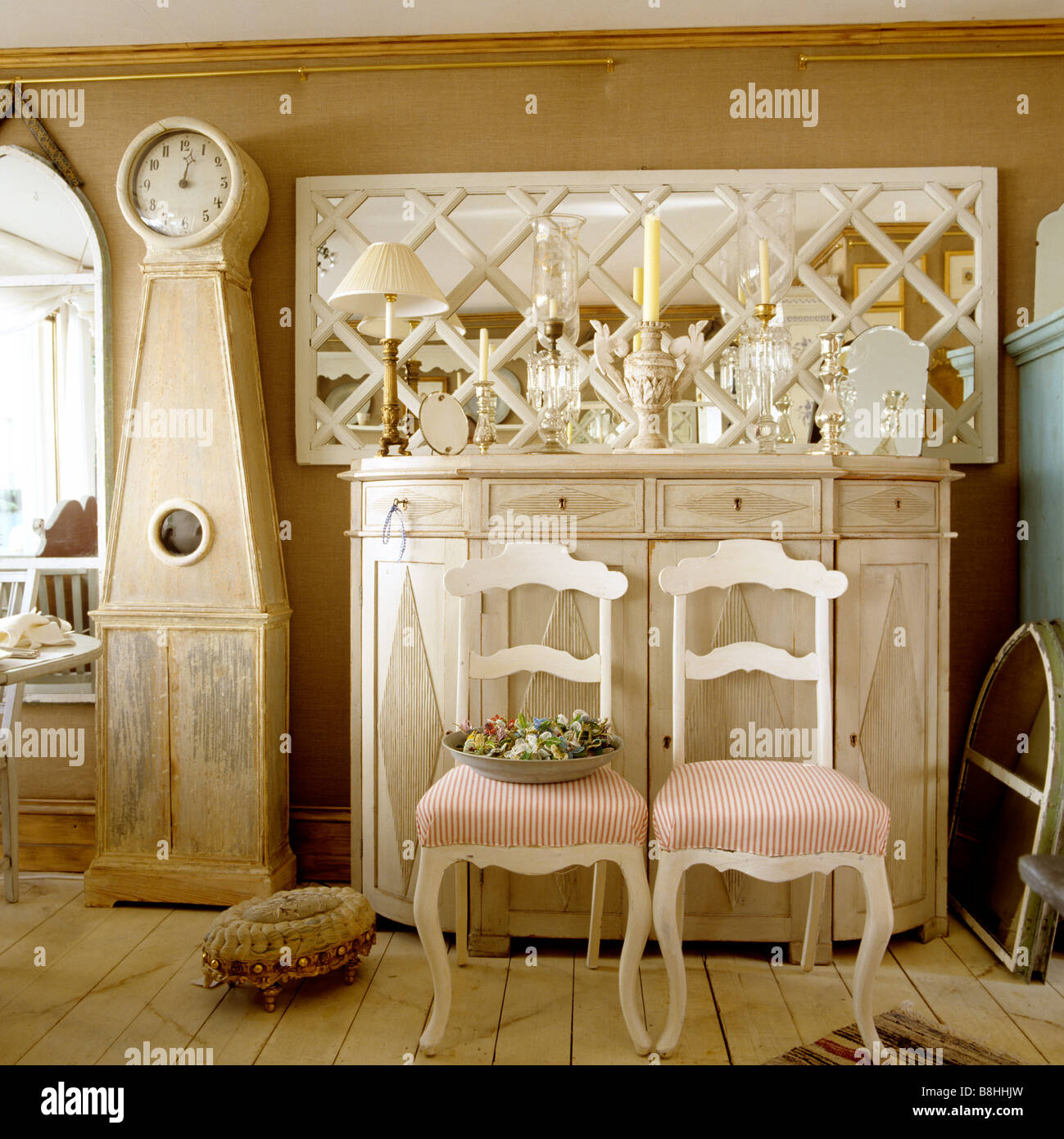 Swedish Longcase Clock And Painted Gustavian Commode With A Trellised  Framed Mirror   Stock Image