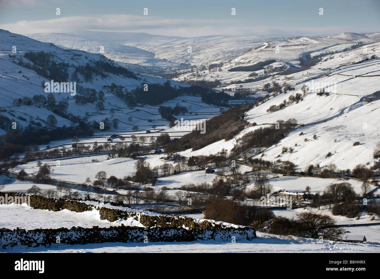 Looking up Swaledale from Whitaside Moor after a snow fall North Yorkshire - Stock Image