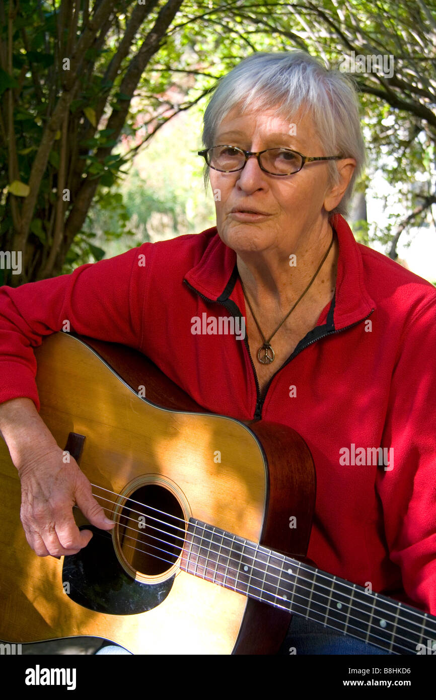 American folk singer songwriter Rosalie Sorrels playing guitar at her home near Boise Idaho - Stock Image