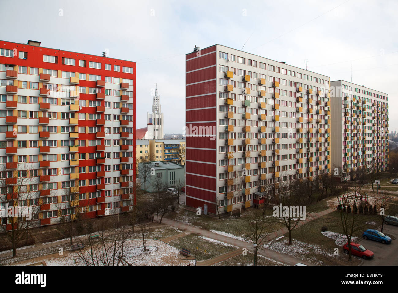 Socialist highrise blocks from the end of 70s and a catholic church in Bialystok in Poland - Stock Image