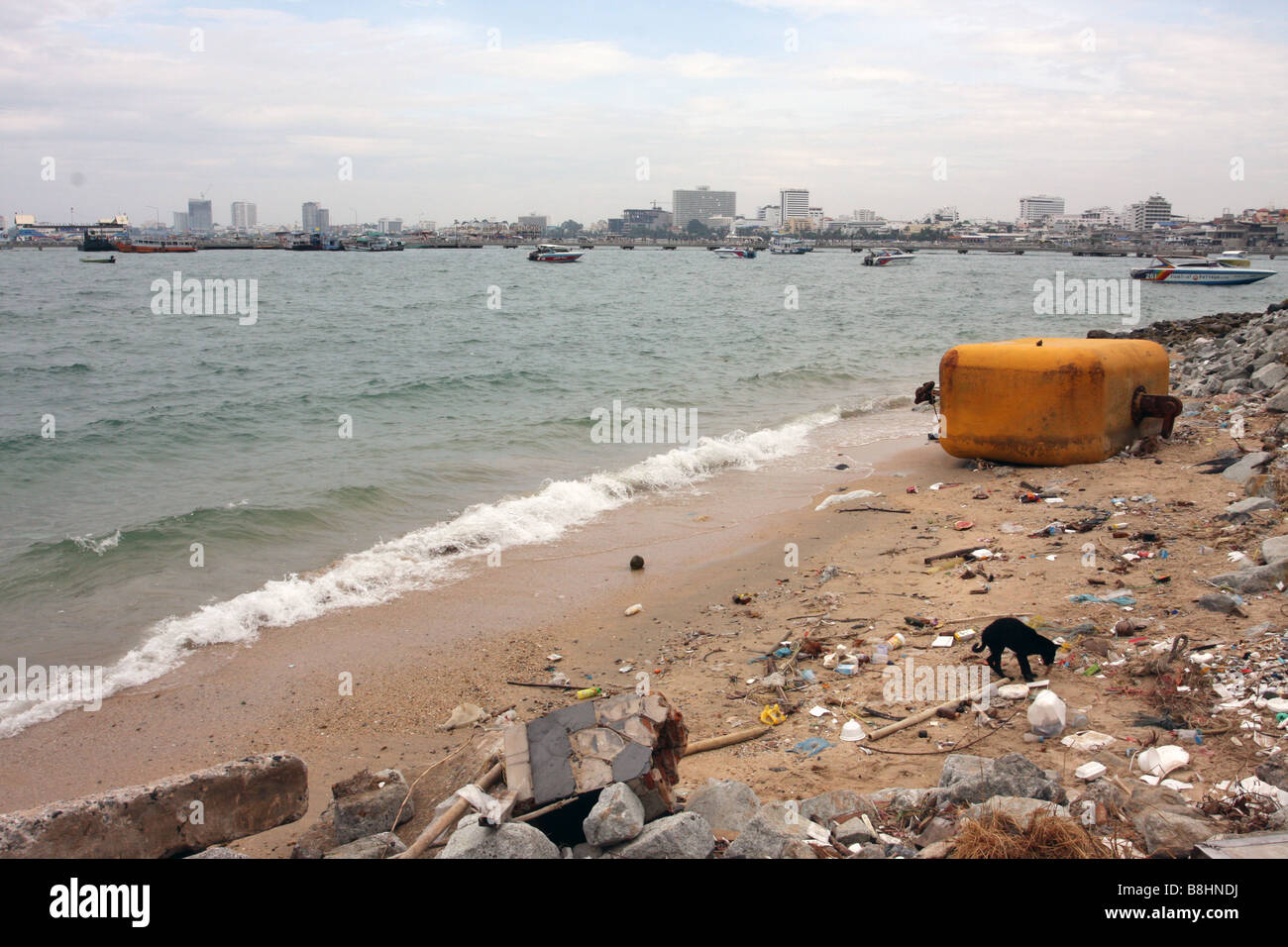 dirty beach in Pattaya Thailand - Stock Image