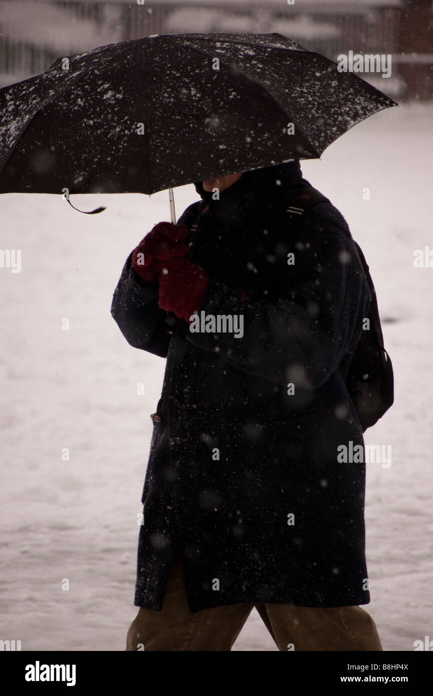 Man with umbrella while snowing - Stock Image