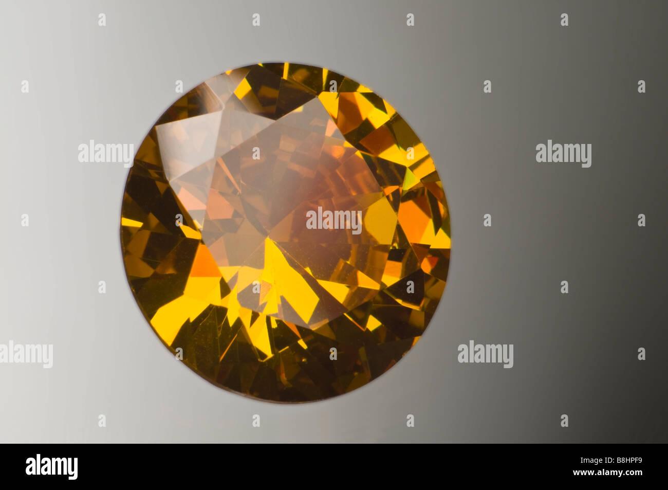 Round-cut Citrine Gemstone (Synthetic; lab-created) - Stock Image