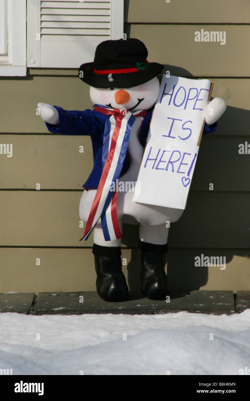 Hope is Here sign held by snowman decoration at the home of Barack Obama supporters on Inauguration Day Jan 20 2009 - Stock Image