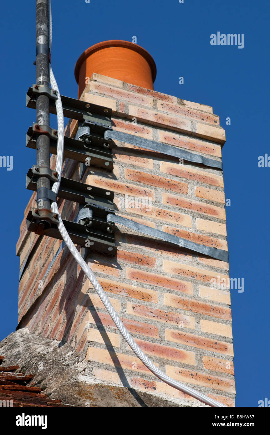 Television aerial support brackets on brick chimney, France. Stock Photo