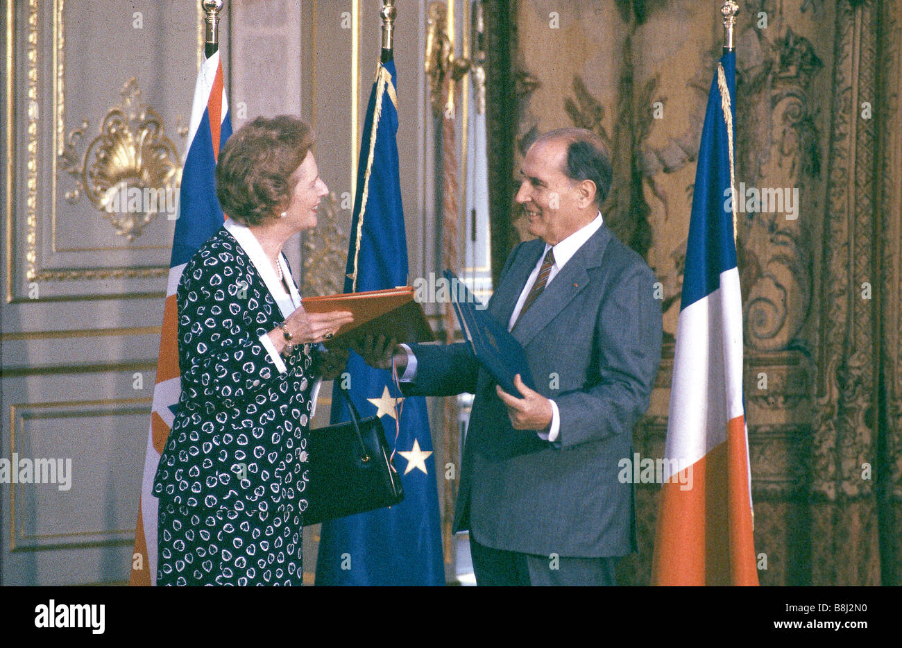 Prime Minister Thatcher and President Mitterrand ratify the Channel Tunnel treaty in 1987, giving the go-ahead for - Stock Image
