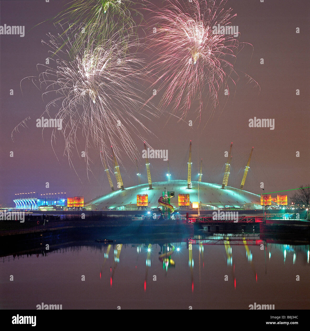 Firework display celebrating the new 2000 millennium over the Millennium Dome/O2 Arena in London. Stock Photo