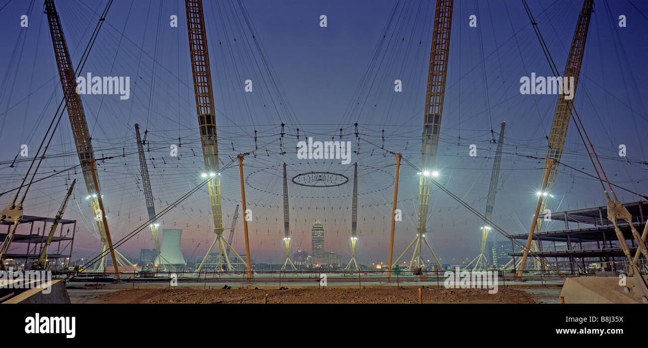 Like a giant spider's web, the cable net structure is raised during construction of the Millennium Dome/O2 Arena Stock Photo