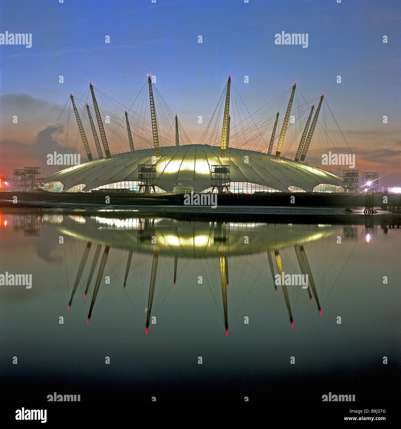 View of the completed structure of the Millennium Dome/O2 Arena in London reflected in the early morning sunrise. Stock Photo