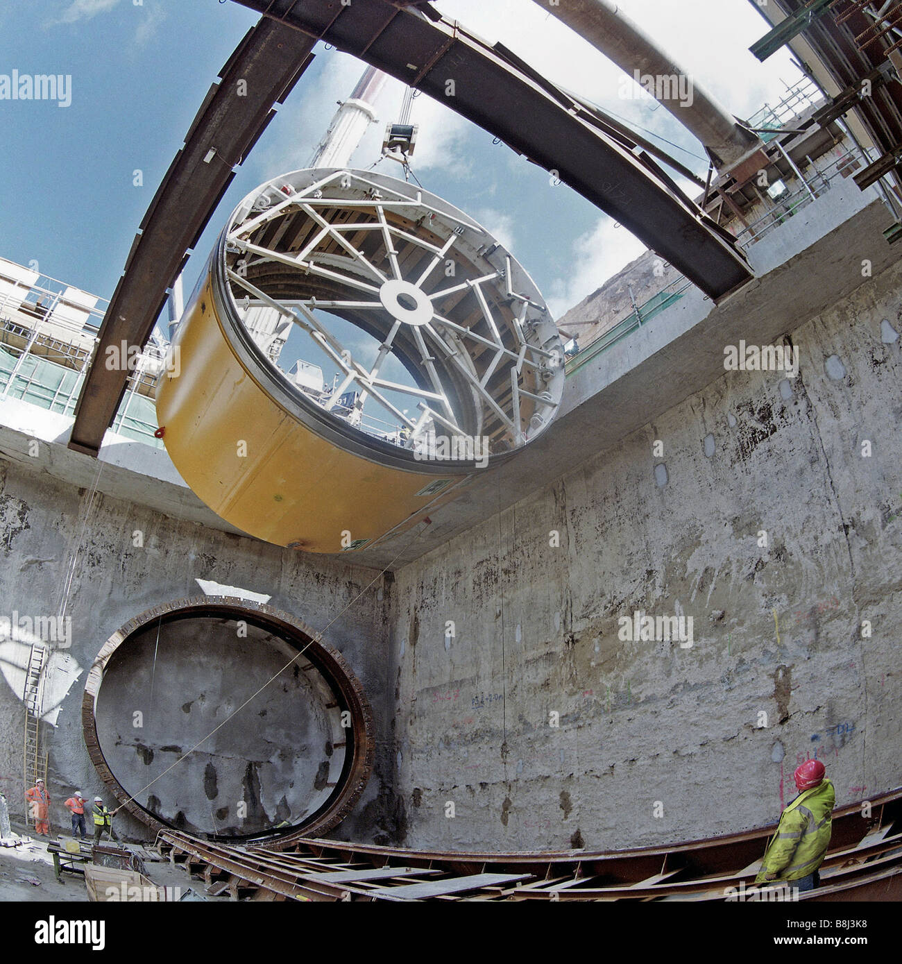 Tunnel boring machine 'Milly the Muncher' for the Thames Tunnel on the Channel Tunnel Rail Link is lowered - Stock Image