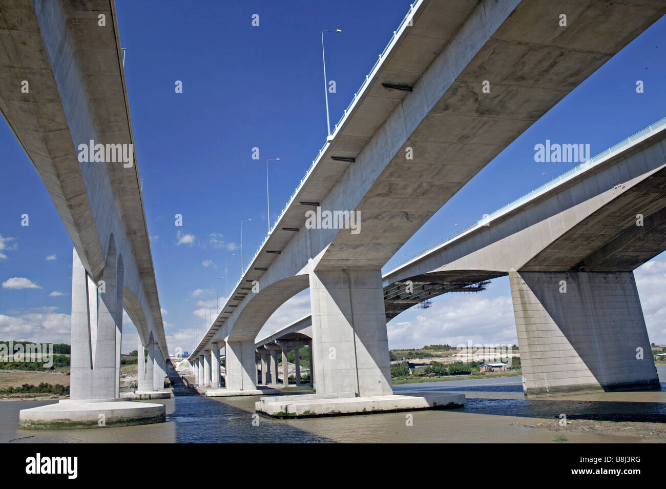 Estuary view of the three bridges that comprise the Medway Crossing. The slender High Speed 1 Eurostar bridge is - Stock Image