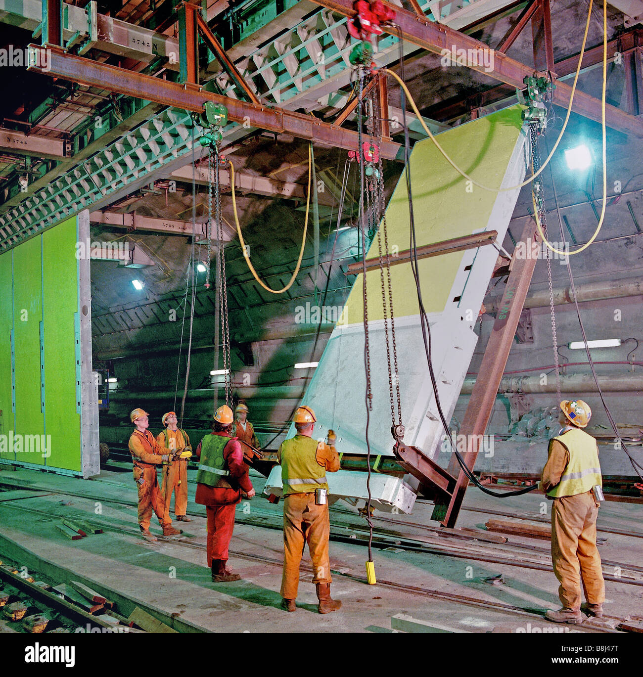 Installing 92 tonne steel doors panels used to separate rail tunnels in an undersea Crossover on the Channel Tunnel - Stock Image