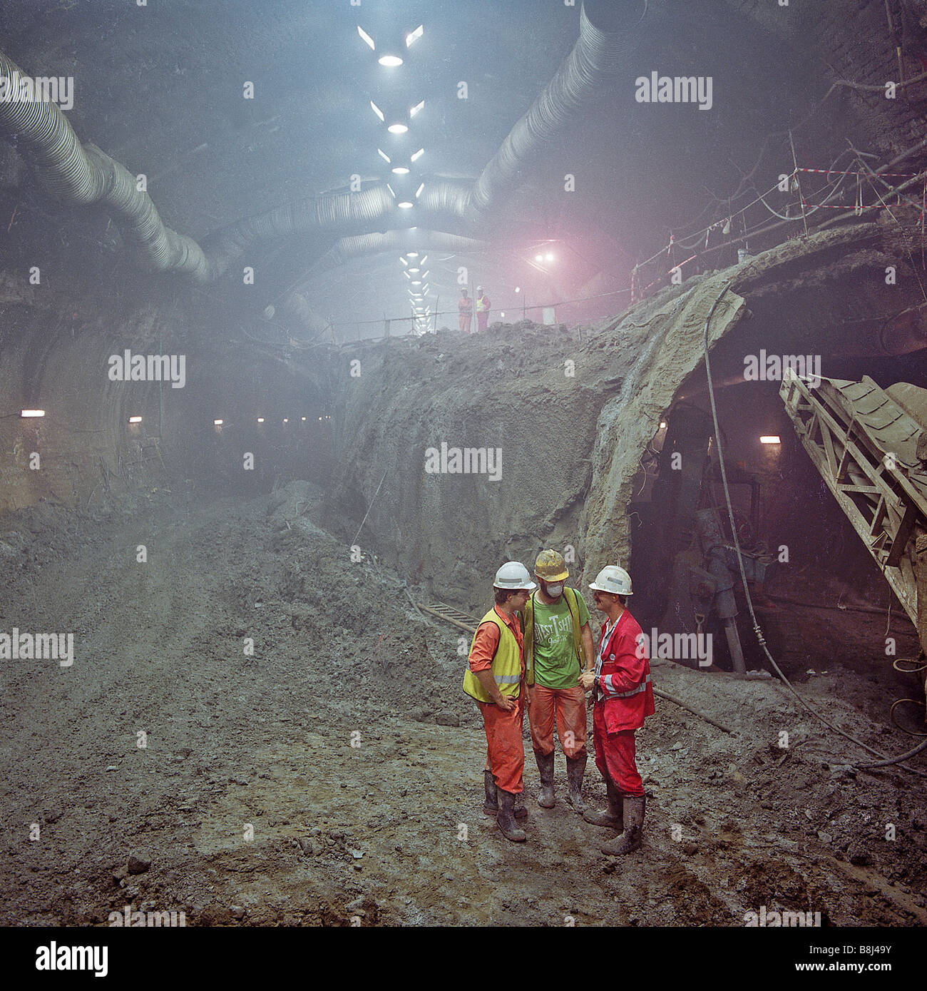 Eurotunnel monitoring engineer checks progress with contractors during construction of the Channel Tunnel UK Crossover - Stock Image