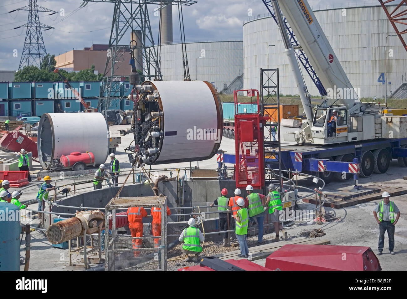 Contractors Lowering A Tunnel Boring Machine Into An