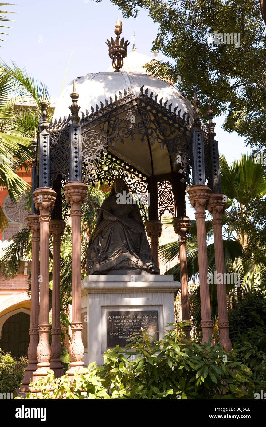 A statue of Queen-Empress Victoria stands in the gardens of Madras ...