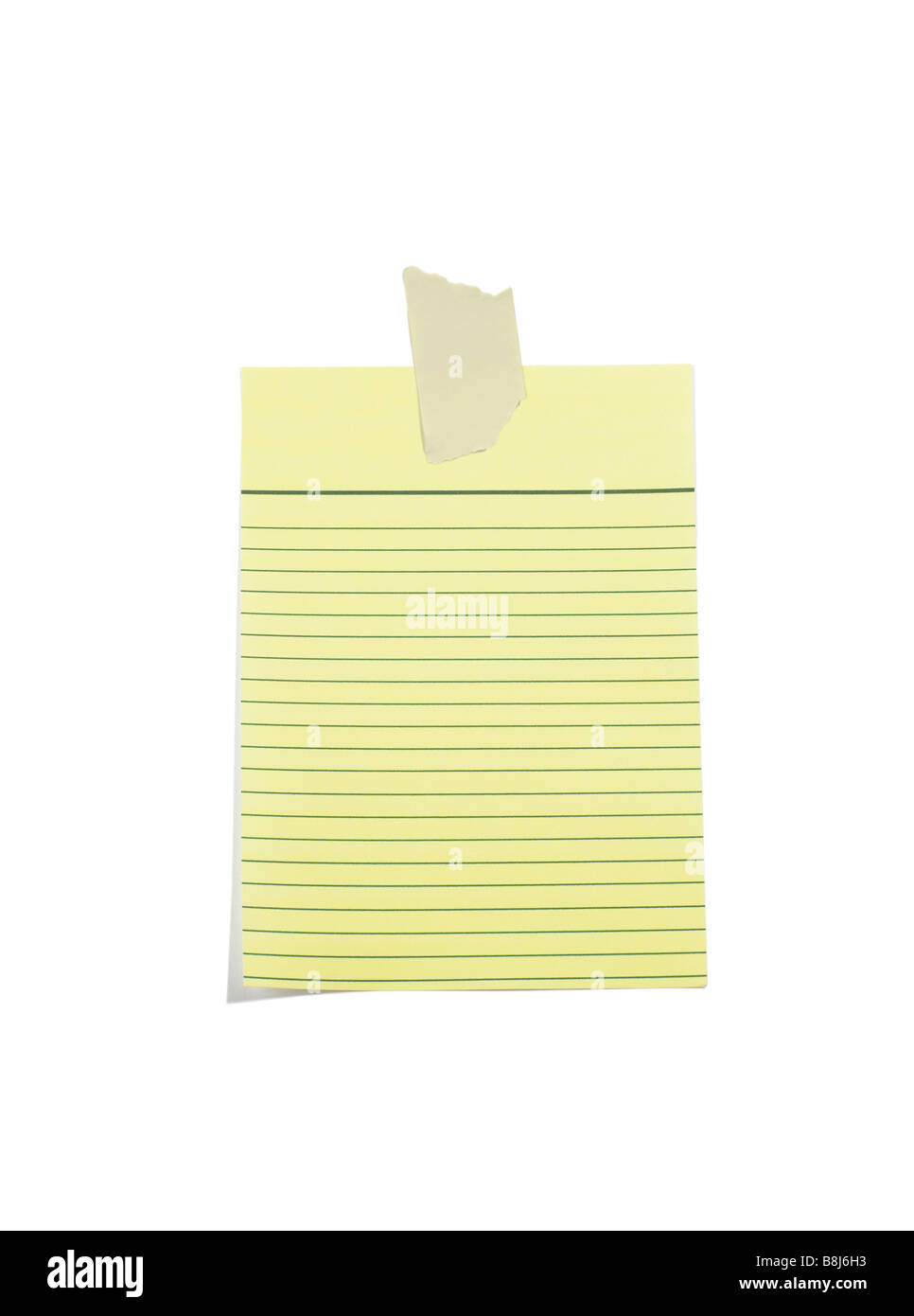 Yellow lined paper with Masking Tape - Stock Image
